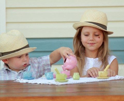 Girl and Boy playing teaparty